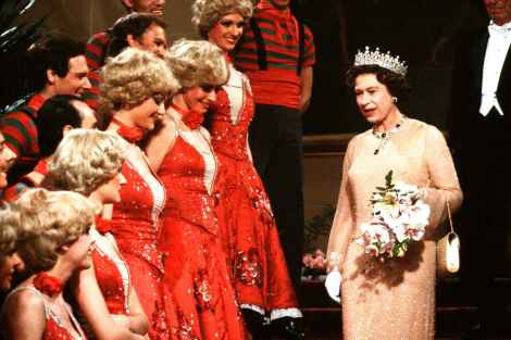 Queen Elizabeth II meets dancers from the Moulin Rouge after a unique private performance. 23 November 1981.