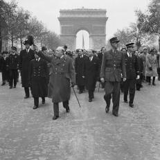Churchill and De Gaulle walk down the Champs Elysées on November 11 1944 Armistice Day Parade